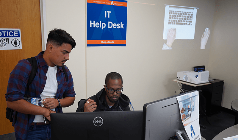 Student helping another student at the IT Help Desk