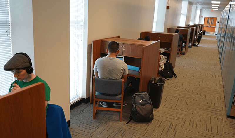 students studying in carrels