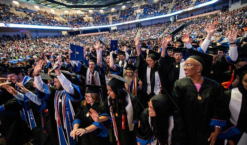 Large crowd of graduates at UTA commencement ceremony
