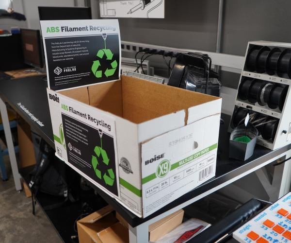 A box with instructions for ABS filament recycling